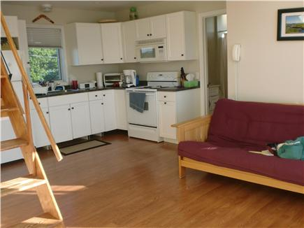 Mattapoisett, Mass. MA vacation rental - Kitchen, living area. Stairs to loft/2nd bedroom. Red futon opens