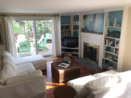 North Truro Cape Cod vacation rental - Living room with gas fireplace with large slider to  back deck