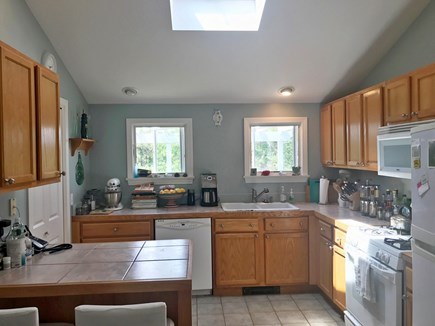 North Truro Cape Cod vacation rental - Kitchen with skylight, gas stove, well stocked for a cook