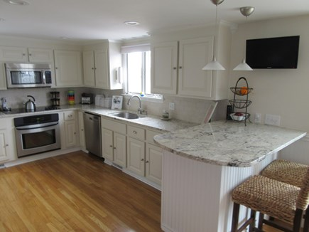 Dennis Cape Cod vacation rental - Peek of beautifully updated kitchen also boasts counter seating