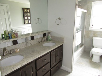 Dennis Cape Cod vacation rental - Renovated guest bath with double sinks