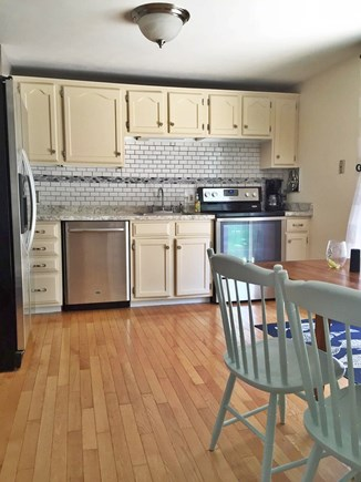 Yarmouthport Cape Cod vacation rental - Kitchen area - slider to deck