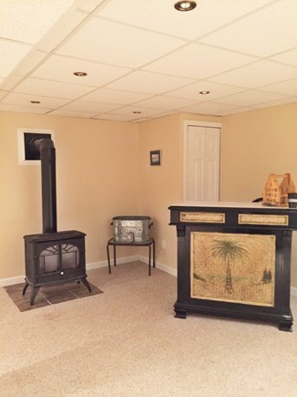 Yarmouthport Cape Cod vacation rental - Gas fireplace bar area and game room