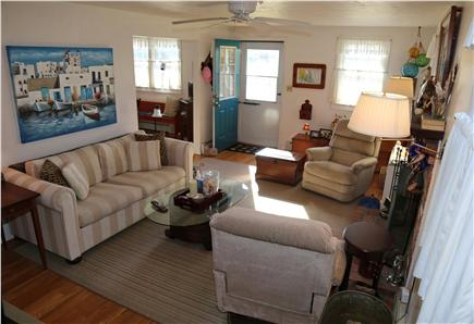 Sandwich Cape Cod vacation rental - Enter into the Living Room with fireplace and marshviews.