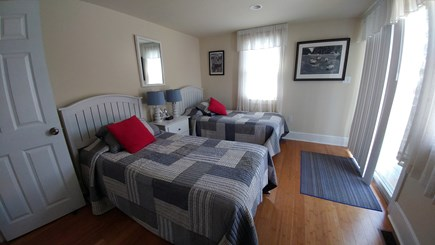 West Dennis Cape Cod vacation rental - Stylish bedroom with 2 twin beds & deck with access to back yard