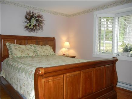 Yarmouth Port Cape Cod vacation rental - Master Bedroom with  Queen bed, window AC, ceiling fan, and TV