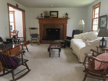 South Chatham Cape Cod vacation rental - Living room with beautiful fireplace, new sofa, cable television.