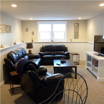 Dennis Cape Cod vacation rental - Lower TV Lounge w/ 3 pc reclining leather set, board games