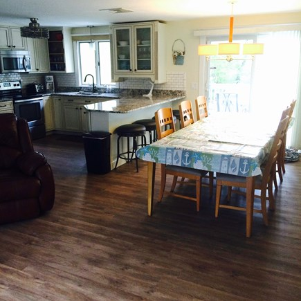 Dennis Cape Cod vacation rental - Spacious open-concept K, DR (seats 12), LR area, slider to deck