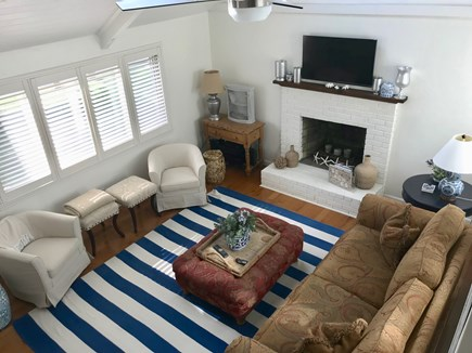 Harwich Port Cape Cod vacation rental - Living Room with cathedral ceiling, FP, stereo and cable HDTV.