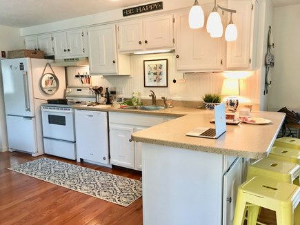 Harwich Port Cape Cod vacation rental - Well appointed cottage Kitchen with barstools & a coffee bar.