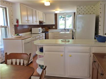 South Wellfleet Cape Cod vacation rental - Kitchen with washer (dryer in basement) and portable dishwasher.