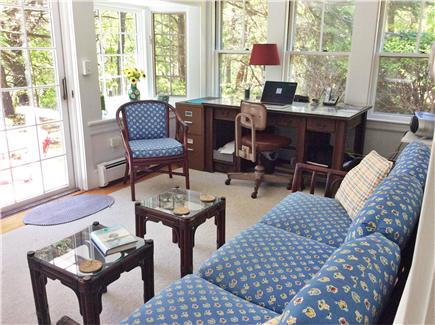 South Wellfleet Cape Cod vacation rental - Sunroom with workspace, French doors to deck.