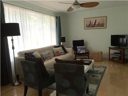 Orleans Cape Cod vacation rental - Relaxing living area open to kitchen with cable TV and free wifi.
