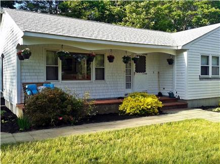 Hyannis Cape Cod vacation rental - Front of the house, with hanging plants - parents loved gardening