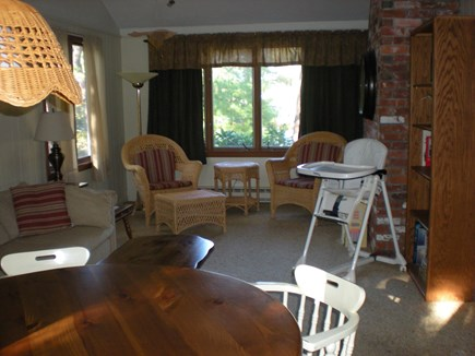 Harwich Cape Cod vacation rental - Great room with breakfast table, sleeper sofa, books, games, TV