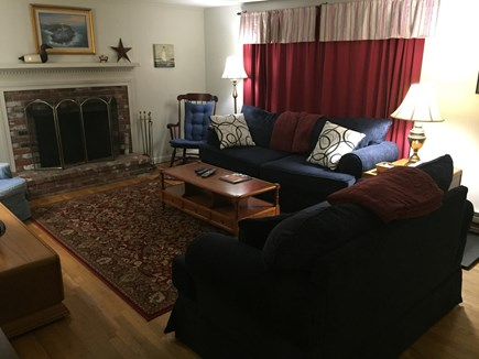 Harwich Cape Cod vacation rental - Living room with sofa, love seat, rugs, flat-screen TV and DVD