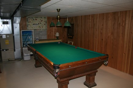 Harwich Cape Cod vacation rental - Basement with game room, laundry room, and queen bed