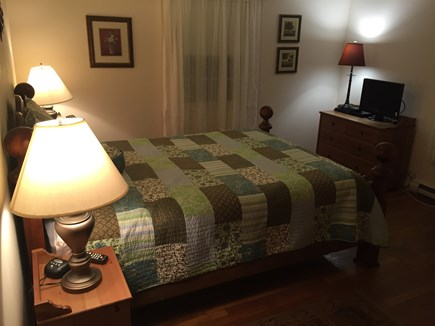 Harwich Cape Cod vacation rental - Master bedroom with queen bed, flat-screen TV, and DVD player