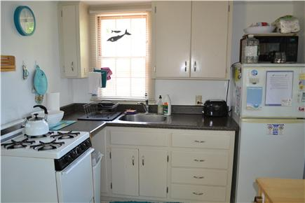 Eastham Cape Cod vacation rental - Fully functional kitchen with refrigerator, stove, and microwave.