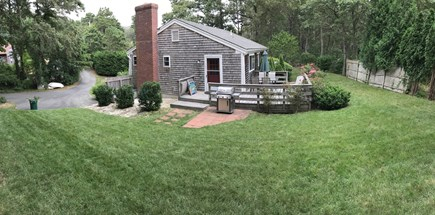 Chatham, Ridgevale Cape Cod vacation rental - Side and back yards. Patio w/shower, fire pit other side of deck
