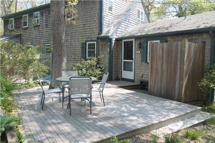 Eastham Cape Cod vacation rental - Shaded back deck and outdoor shower.