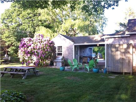 Chatham Harbor Fish Pier Cape Cod vacation rental - Breezeway, patio, outdoor shower and barbecue area.