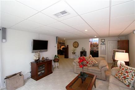 Harwich Cape Cod vacation rental - Lower level walkout living area with TV, wet bar, and full bath