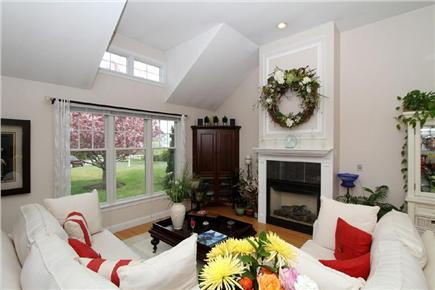 Harwich Cape Cod vacation rental - Bright and airy living room with gas fireplace
