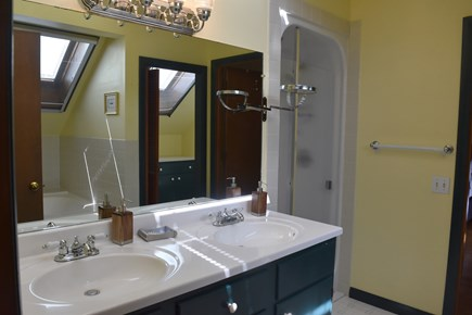 North Chatham Cape Cod vacation rental - Upper level bathroom has double sink shower, tub,WC and skylights
