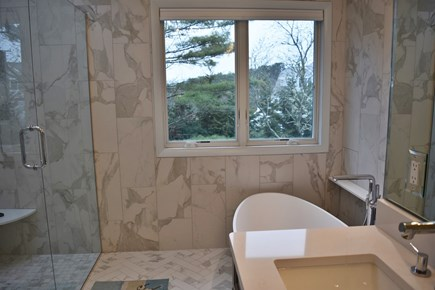Chatham Cape Cod vacation rental - Luxury ensuite bathroom has freestanding tub and makeup area