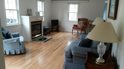 Eastham Cape Cod vacation rental - Living Room with Gas Fireplace and New Hardwood Floors