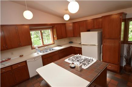 Orleans Cape Cod vacation rental - Kitchen with vaulted ceilings and center island, washer/dryer
