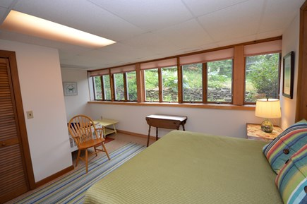 Orleans Cape Cod vacation rental - Lower level bedroom with queen bed, full wall of windows