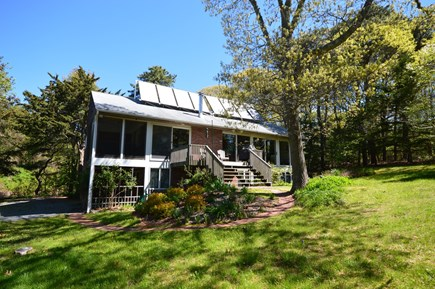 Orleans Cape Cod vacation rental - Large, private backyard. Deck with grill and lounge chairs.