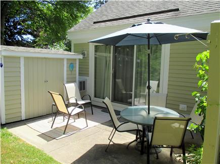 Brewster Cape Cod vacation rental - Patio with Table ~ New Chairs & Umbrella