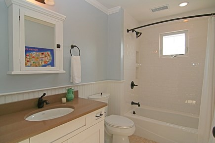 Barnstable Village Cape Cod vacation rental - Upstairs bathroom with a tub/shower.