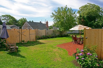 Barnstable Village Cape Cod vacation rental - Behind Fence: shed area with bikes, beach gear and more