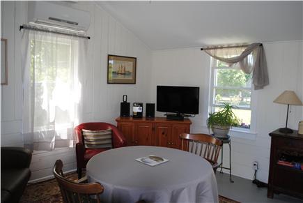 Barnstable, Cummaquid Cape Cod vacation rental - Living room and eat in kitchen combo.