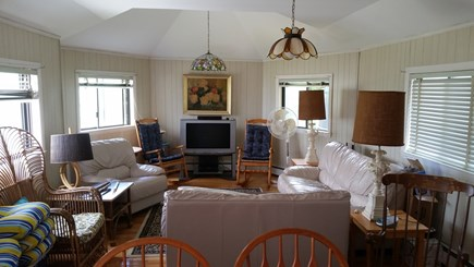 East Falmouth Cape Cod vacation rental - Family room with accessibility to deck in rear of house