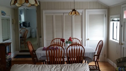 East Falmouth Cape Cod vacation rental - Eating area in family room with accessibility to rear deck