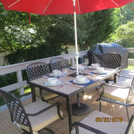West Dennis Cape Cod vacation rental - Deck off kitchen leading to fenced in back yard.