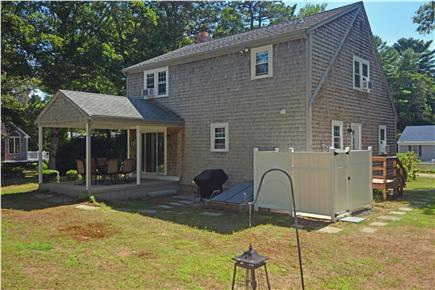 North Falmouth Cape Cod vacation rental - Back with large outdoor shower and covered patio