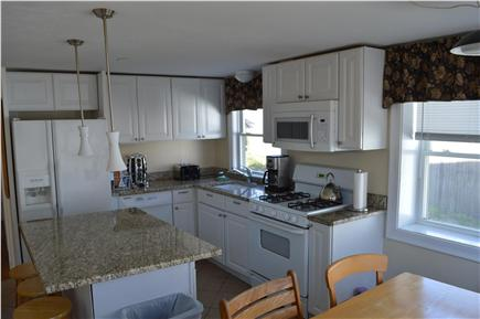 Hyannis Cape Cod vacation rental - Kitchen with table for 6 and stools on island for 3 people