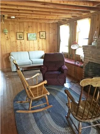 Brewster Cape Cod vacation rental - Living room with wood burning fireplace and comfortable seating