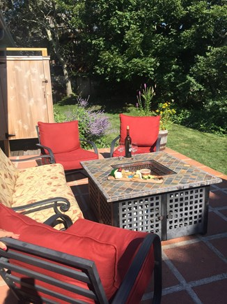 Provincetown Cape Cod vacation rental - Back patio - featuring new outdoor shower and fire pit.