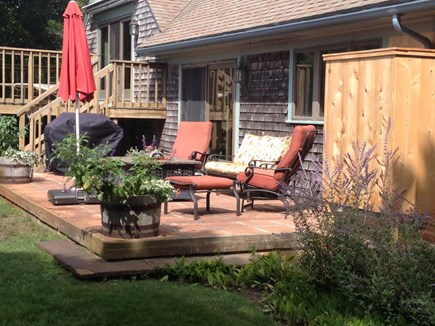 Provincetown Cape Cod vacation rental - Deck off family room and patio with fire pit off kitchen