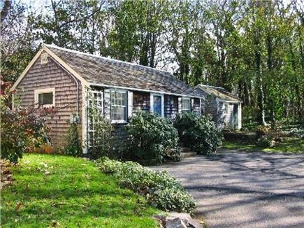 Orleans Cape Cod vacation rental - Front view of cottage, adjacent shed, and guest parking area