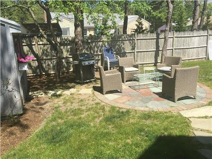 West Yarmouth Cape Cod vacation rental - Backyard patio for conversation, grilling, and fun