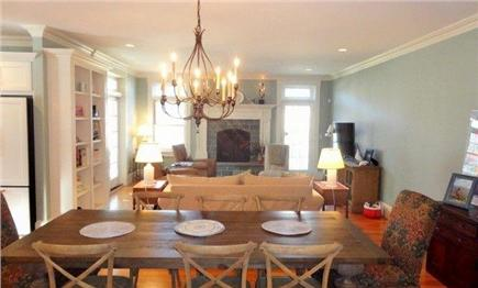 West Yarmouth Cape Cod vacation rental - Open living, dining, and kitchen area with gas fireplace